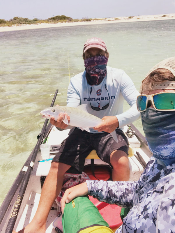 Capt Brian and son Ryan with a catch and release Bonefish at Dry Tortugas